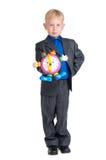 pojkeklockaholding Fotografering för Bildbyråer