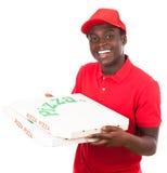 pojkeleveransen tycker om din lunchpizza Arkivbild