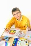 pojkemålning Arkivbild