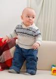 pojken costs little sofa Royaltyfri Foto
