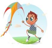 Pojken flyger hans drake Arkivfoton