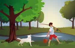 Pojken går att fiska med en viktig hund Royaltyfri Foto