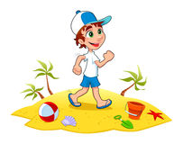Pojken går på sanden. Arkivbild