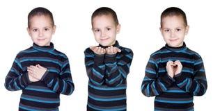 pojken göra en gest handen Fotografering för Bildbyråer