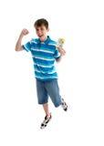 pojken hoppar teen välståndframgång Royaltyfria Foton