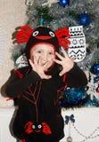 Pojken i den nya dräktspindeln Royaltyfri Fotografi