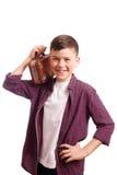 Pojken med en liten resväska Arkivfoton