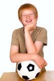 Pojken med klumpa ihop sig Fotografering för Bildbyråer