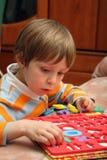 pojken numrerar plastic barn Royaltyfri Fotografi