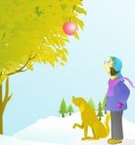 pojken och hans hund ser ett äpple Fotografering för Bildbyråer