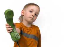 Pojken och telefonen Royaltyfri Bild