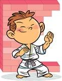 Pojken, som är förlovad i karate royaltyfri illustrationer