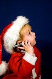 pojken som kallar jul, avlar little till Arkivfoto
