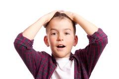 Pojken som låtsas för att skrämmas Fotografering för Bildbyråer