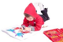 pojken tecknar arkivfoto