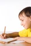 pojken tecknar barn royaltyfri fotografi