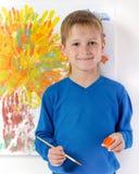 pojken tecknar bilden Fotografering för Bildbyråer