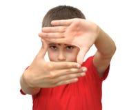 pojkesinnesrörelse göra en gest shows Royaltyfria Foton