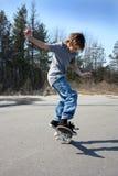 pojkeskateboard Arkivbild