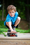 pojkeskateboard Arkivfoto