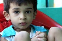 pojkestolssitting Fotografering för Bildbyråer