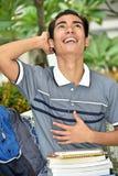 Pojkestudent And Laughter royaltyfri foto