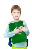 Pojkestudent med påsen och böcker royaltyfri foto