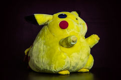 Pokémon center plush doll Pikachu on black background Stock Image
