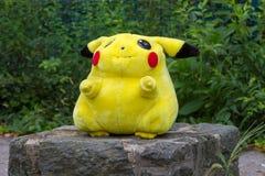 Pokémon center plush doll Pikachu. Pokémon center plush doll Pikachu on public park Stock Photo