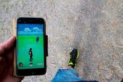 Pokémon hunt. Looking for Pokemon on the walk Stock Photos