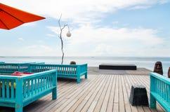 Pokładu patio przy oceanem i krzesło Obrazy Royalty Free