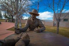 Pokazuje niską Arizona statuę sławna karciana gra Obrazy Royalty Free