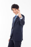 Pokazywać kciukowi młodego Azjatyckiego biznesowego mężczyzna. Zdjęcie Stock