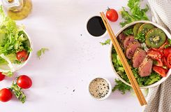 Buddha bowl. Traditional salad with pieces of medium-rare grilled Ahi tuna royalty free stock photography