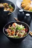 Poke bowl with salmon and vegetables Royalty Free Stock Images