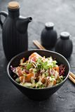 Poke bowl with salmon and vegetables Royalty Free Stock Photo