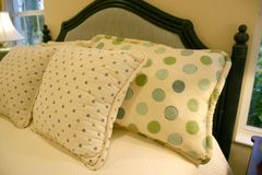 Poke-a-dot Pillows. Two sizes of green and blue poke-a-dots Stock Photo