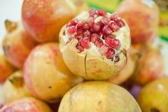 Poke pomegranate Royalty Free Stock Photo