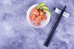 Poke, sticks, place for text. Rice, fish, avocado and sesame. Hawaiian traditional dish Stock Images