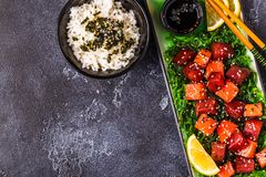 Poke, traditional Hawaiian raw fish salad. Top view Royalty Free Stock Image