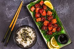 Poke, traditional Hawaiian raw fish salad. Top view Stock Photos