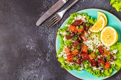 Poke, traditional Hawaiian raw fish salad. Top view Royalty Free Stock Images