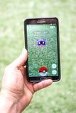 Pokemon是在电话的gameplay screenshot 库存照片