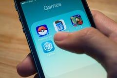 Pokemon идет, вход и другие популярные значки применения игры Стоковое Изображение RF