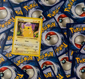 Pokemon cards with Pikachu. Pokemon cards background with a Pikachu card on top Stock Images