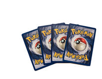 Pokemon cards on white. Pokemon cards isolated on a white background Royalty Free Stock Photos