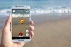Pokemon Encounter in Pokemon GO. SANTA CRUZ, CALIFORNIA - JULY 15, 2016: The hit augmented reality smartphone app Pokemon GO shows a Pokemon encounter at the Royalty Free Stock Image