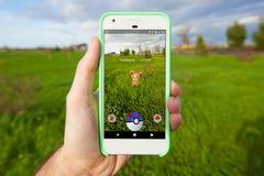 Pokemon GÅR att fånga för den andra utvecklingen Royaltyfri Foto