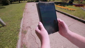 Pokemon Go app being played by a man on his tablet. stock video