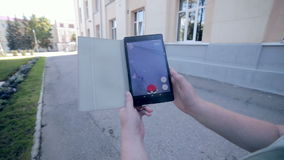 Pokemon Go app being played by a man on his tablet. stock video footage